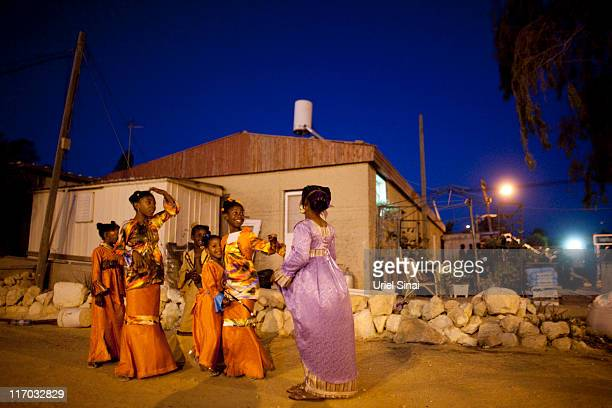 Members of the Black Hebrews community celebrate the Shavuot harvest festival on June 2011 in Dimona Israel The community who call themselves the...