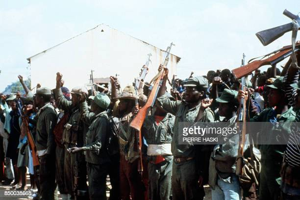 Members of the black nationalist guerrillas of the Zimbabwe African Liberation Army led by Robert Mugabe stage a rally 06 February 1980 somewhere in...