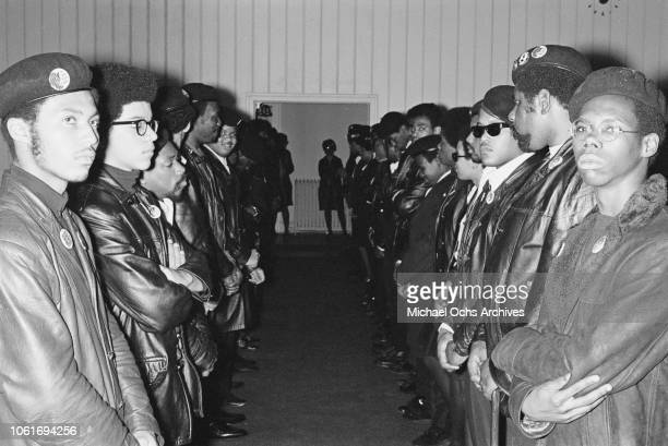 Members of the Black Panther Party attend the funeral of a baby of one of the Black Panthers and a Swedish mother, USA, 19th April 1969. The man on...
