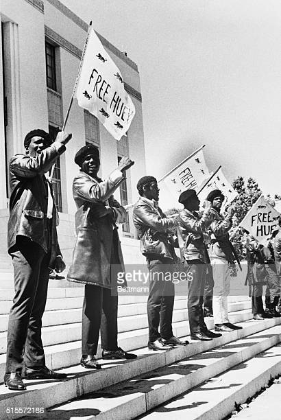 Members of the Black Panther Party demonstrate on the steps of the Alameda County Courthouse in Oakland, California. They are calling for the release...