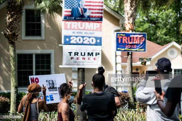 """Members of the Black Panther Party, """"I Fight For My People"""", and """"My Vote is Hip Hop"""" demonstrate in the Satilla Shores neighborhood on May 9, 2020..."""