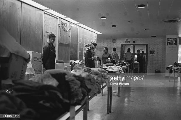 Members of the Black Panther Party stand behind tables ready to distribute free clothing to the public New Haven Connecticut September 28 1969
