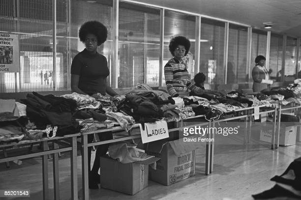 Members of the Black Panther Party stand behind tables ready to distribute free clothing to the public, New Haven, Connecticut, September 28, 1969.
