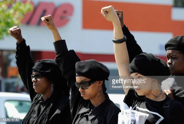 Members of the Black Riders, a new generation of the Black Panther Party, participate in a rally at the intersection of Florence and Normandie...