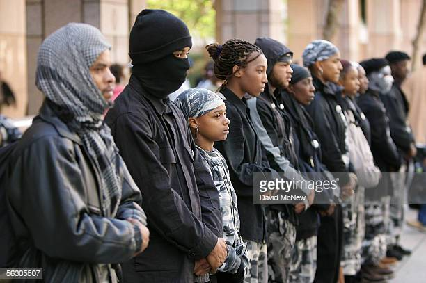 Members of the Black Riders Liberation Party demonstrate in front of the office of California Gov Arnold Schwarzenegger to urge the governor to grant...