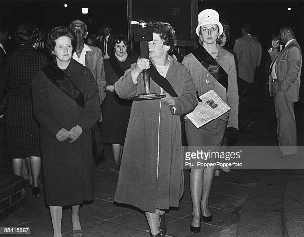 Members of the Black Sash movement carrying the Freedom Flame during a protest in Johannesburg circa 1955 The Black Sash was a women's movement...