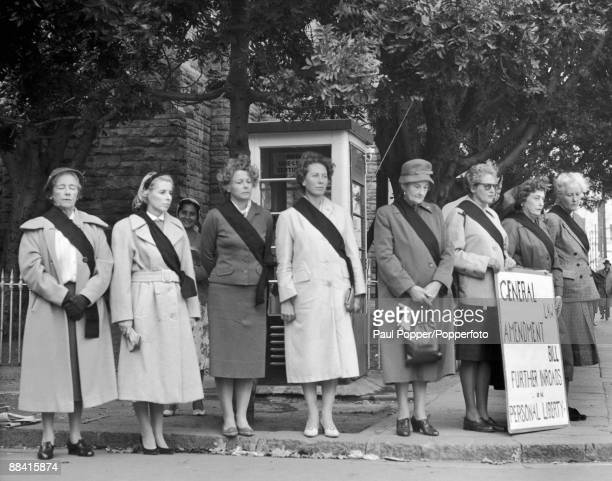 Members of the Black Sash movement hold a demonstration outside the South African parliament in Cape Town to protest against the General Law...