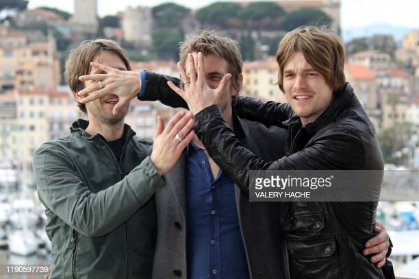 Members of The Black swan effect band Gareth Hale Dominic Greensmith and Jesse Wood pose during a photocall on January 26 2010 in Cannes southeastern...