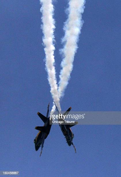 Members of the Blue Angels perform an aerial maneuver during the Chicago Air and Water Show at North Avenue Beach in Chicago Illinois on Saturday...
