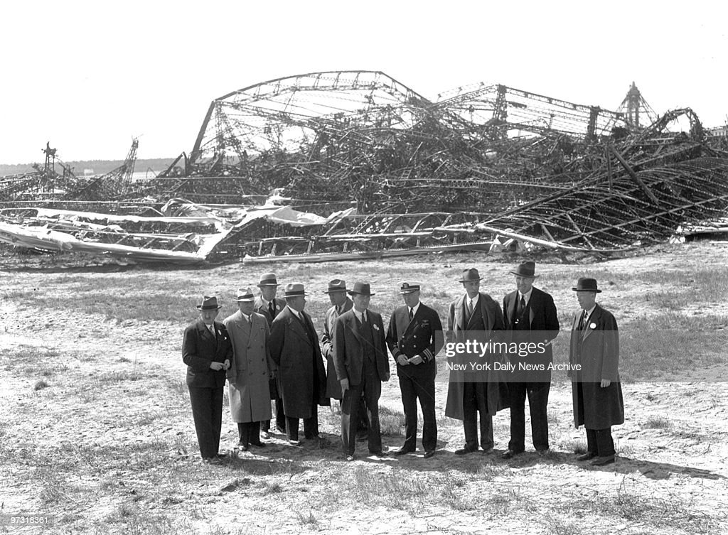 Members of the Board of Inquiry for the Department of Commerce look over ruins of the Hindenburg at Lakehurst as probe into the dirigible's expl;osion opened.