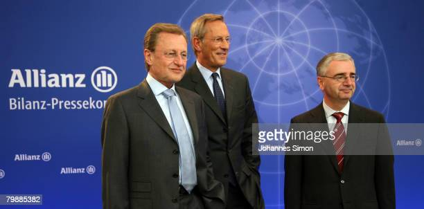 Members of the board of the Allianz insurance group Helmut Perlet Michael Diekmann and Paul Achleitner pose prior to the announcement of the 2007...