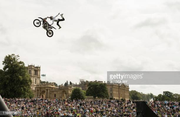 Members of the Bolddog Lings FMX Display Team perform in the Grand Ring on the first day of the Chatsworth Country Fair in the grounds of Chatsworth...