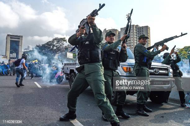 Members of the Bolivarian National Guard who joined Venezuelan opposition leader and self-proclaimed acting president Juan Guaido fire into the air...