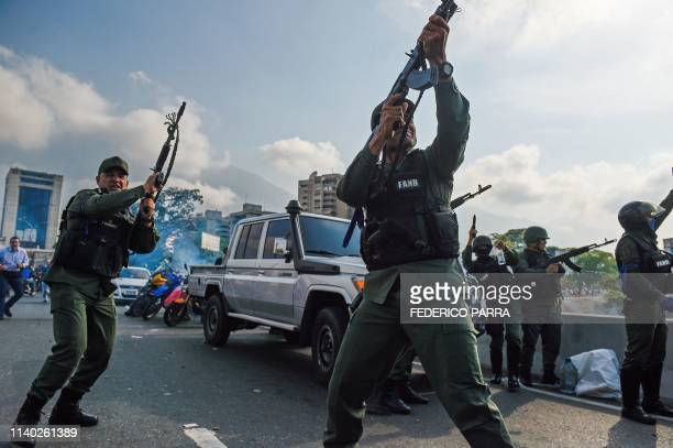 Members of the Bolivarian National Guard who joined Venezuelan opposition leader and selfproclaimed acting president Juan Guaido fire into the air to...