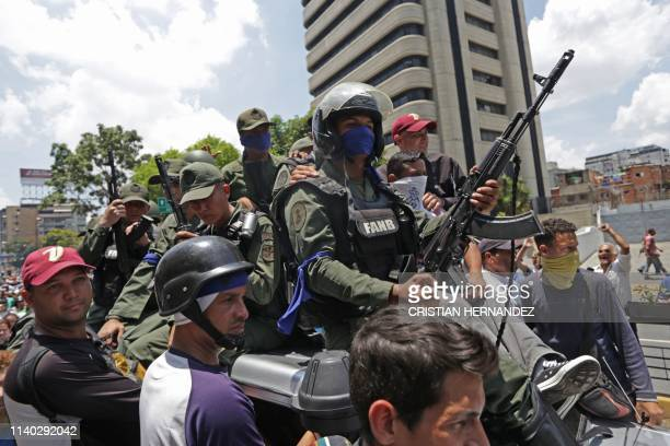 Members of the Bolivarian National Guard who joined Venezuelan opposition leader and selfproclaimed acting president Juan Guaido in his campaign to...