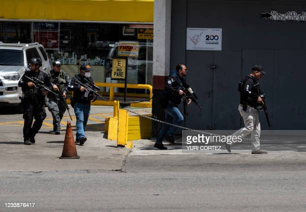 Members of the Bolivarian National Intelligence Service arrive to the area of clashes between police and alleged members of a criminal gang in the...