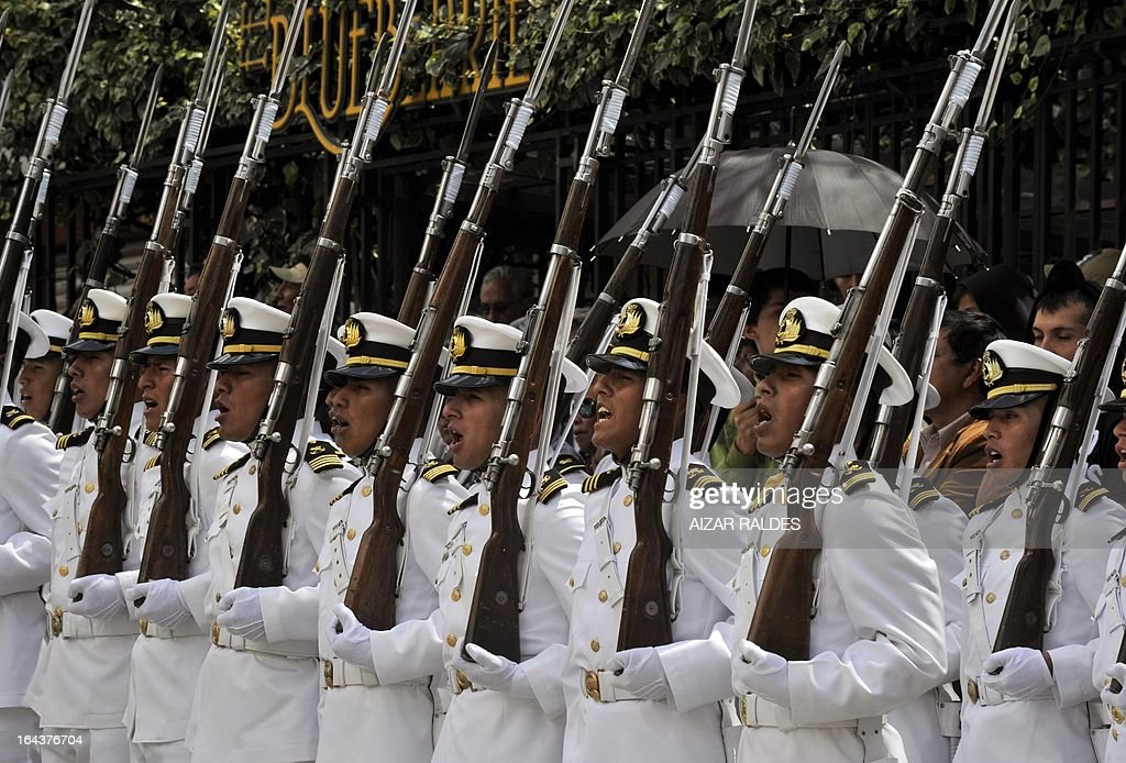 Members of the Bolivian Navy sing the national anthem during a ceremony to commemorate the 134th anniversary of the Battle of Calama in which Bolivia lost its access to the sea to Chile, in La Paz on March 23, 2013. Bolivian President Evo Morales said Saturday he would file a suit against Chile at the International Court of Justice 'in the coming days' in a bid to reclaim access to the sea lost in a 19th century war. During the event in honour of the 'Day of the Sea' -- commemorating the war that left impoverished Bolivia landlocked -- President Morales said he hoped to resolve the dispute through 'peaceful settlement mechanisms.'