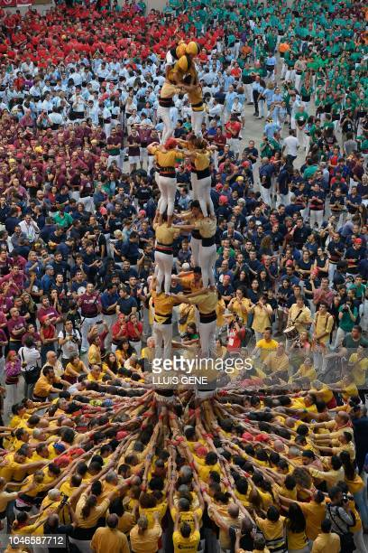 Members of the Bordegassos de Vilanova human tower team form a castell during the XXVII human towers or 'castells' competetion in Tarragona on...