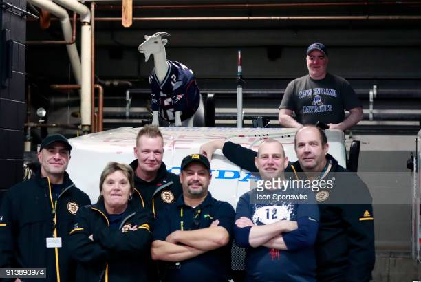 Members of the Boston Bruins bull gang pose with their tribute to Tom Brady and the New England Patriots in Super Bowl LII before a game between the...