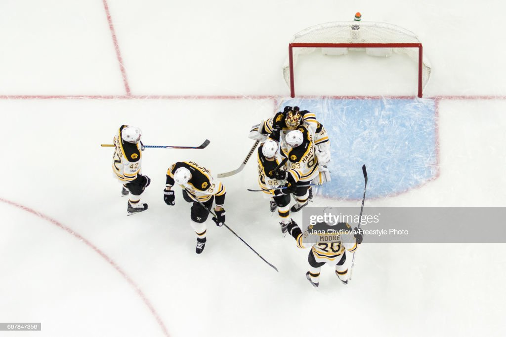 Members of the Boston Bruins celebrate a win against the Ottawa Senators in Game One of the Eastern Conference First Round during the 2017 NHL Stanley Cup Playoffs at Canadian Tire Centre on April 12, 2017 in Ottawa, Ontario, Canada.