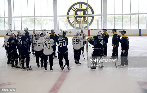 Members of the Boston Bruins organization stand at center ice during training camp at Warrior Ice Arena in Boston on Sept 23 2016
