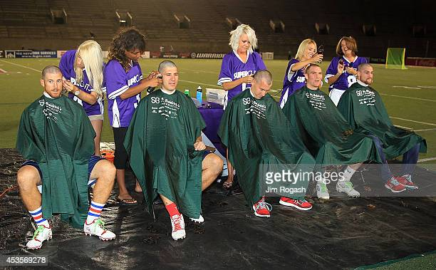 Members of the Boston Cannons have their heads shave for a charity after a game with the Rochester Rattlers at Harvard Stadium on August 9 2014 in...