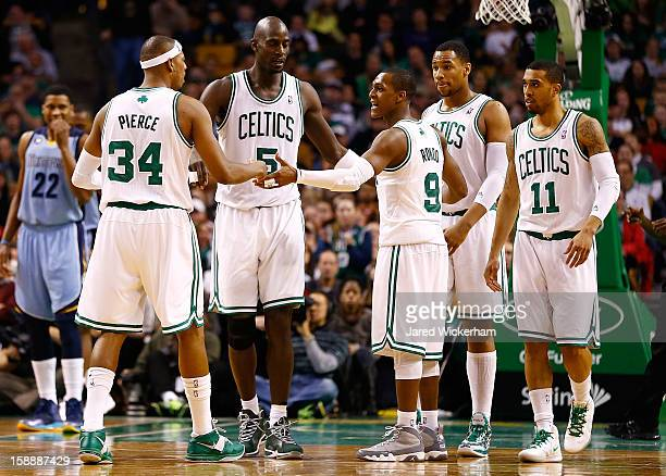 Members of the Boston Celtics including Rajon Rondo Kevin Garnett Paul Pierce Jared Sullinger and Courtney Lee huddle during the game against the...
