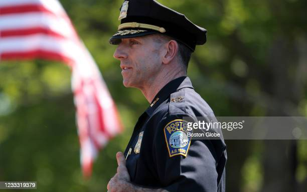 Members of the Boston Police Department lower their heads during a moment of silence during the Boston Police Relief Associations annual Memorial Day...