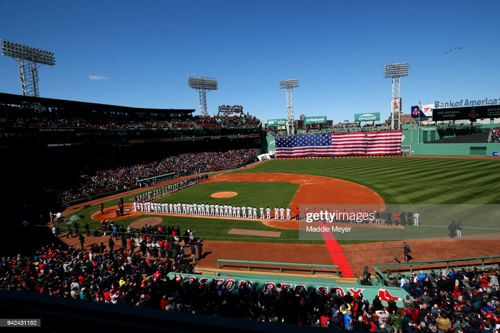 Members of the Boston Red Sox and the Tampa Bay Rays stand for the national anthem before the Red Sox home opening game at Fenway Park on April 5, 2018 in Boston, Massachusetts.
