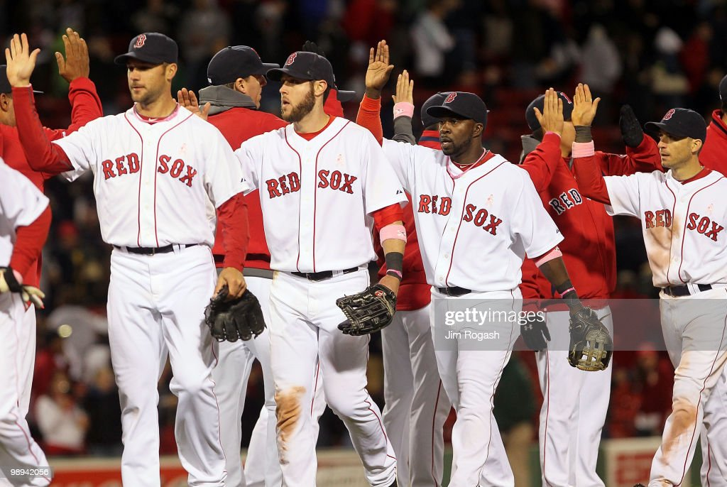Members of the Boston Red Sox celebrate after defeating the New York Yankees, 9-3, at Fenway Park on May 9, 2010 in Boston, Massachusetts.