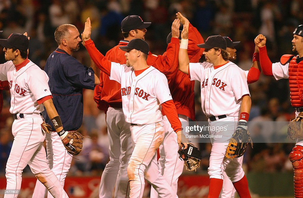 Members of the Boston Red Sox give high fives following their 6-1 win over the Seattle Mariners at Fenway Park August 24, 2003 in Boston, Massachusetts. The Red Sox further tightened the American League east race with the Yankees.