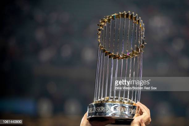 Members of the Boston Red Sox hold up the World Series trophy after winning the 2018 World Series in game five against the Los Angeles Dodgers on...