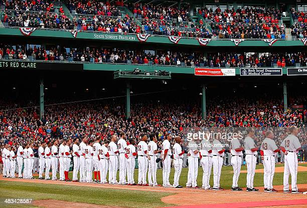 Members of the Boston Red Sox line up along the first base line prior to the Opening Day game against the Milwaukee Brewers on April 4 2014 in Boston...