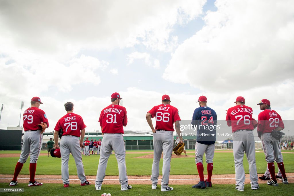 Members of the Boston Red Sox look on during a team workout on February 21, 2018 at jetBlue Park at Fenway South in Fort Myers, Florida .
