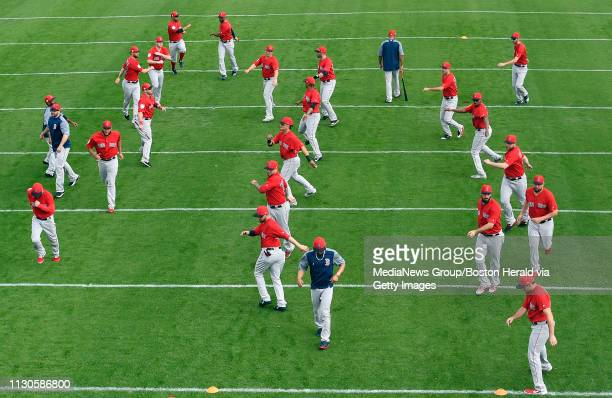 Members of the Boston Red Sox loosen up during a spring training workout in Fort Myers Florida on February 18 2019