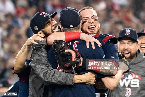Members of the Boston Red Sox mob David Price Chris Sale and Christian Vazquez of the Boston Red Sox after the final out was recorded to win the 2018...