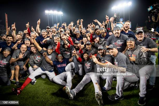 Members of the Boston Red Sox pose for a team photograph as they celebrate after winning the 2018 World Series in game five against the Los Angeles...