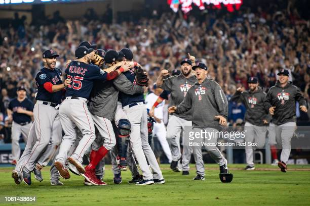 Members of the Boston Red Sox react after the final out was recorded to win the 2018 World Series in game five against the Los Angeles Dodgers on...