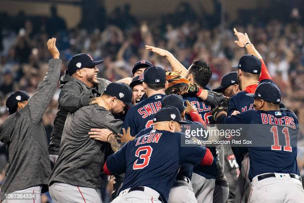 Members of the Boston Red Sox react with Chris Sale after the final out was recorded to win the 2018 World Series in game five against the Los...