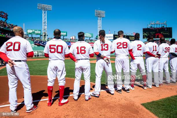 Members of the Boston Red Sox stand during the national anthem before the Opening Day game against the Tampa Bay Rays on April 5 2018 at Fenway Park...