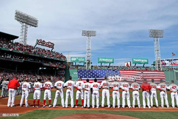 Members of the Boston Red Sox stand for the national anthem before the opening day game against the Pittsburgh Pirates at Fenway Park on April 3 2017...
