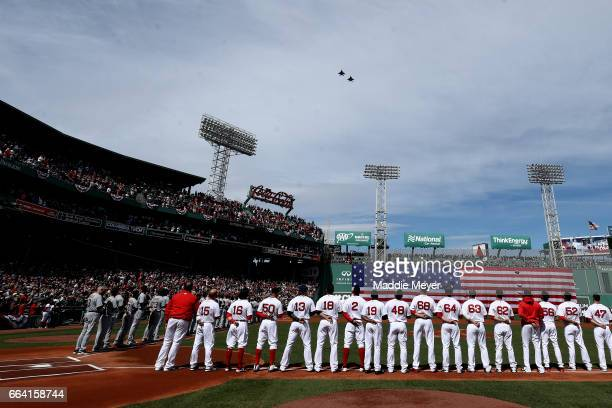 Members of the Boston Red Sox stand for the national anthem before the opening day game between the Boston Red Sox and the Pittsburgh Pirates at...