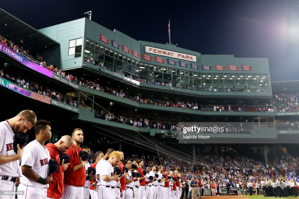 Members of the Boston Red Sox stand for the national anthem before their game against the Toronto Blue Jays at Fenway Park on September 26, 2017 in Boston, Massachusetts.
