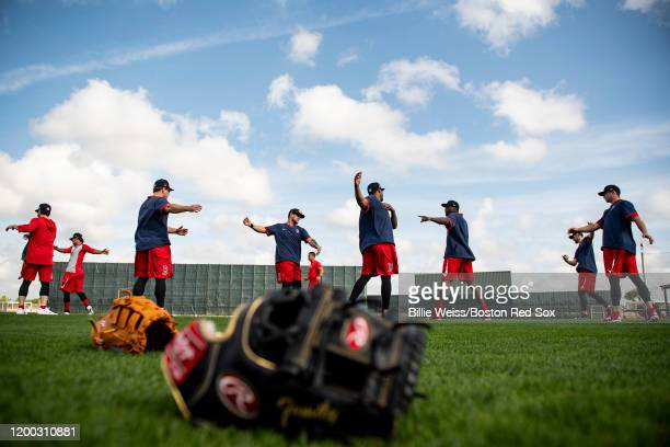 Members of the Boston Red Sox stretch during a team workout on February 12 2020 at JetBlue Park at Fenway South in Fort Myers Florida