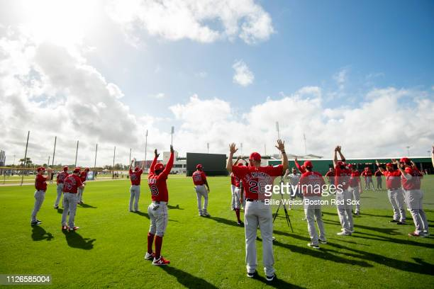 Members of the Boston Red Sox stretch during a team workout on February 21 2019 at JetBlue Park at Fenway South in Fort Myers Florida