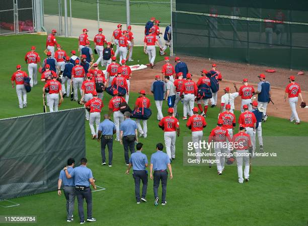 Members of the Boston Red Sox walk out to the practice fields during a spring training workout in Fort Myers Florida on February 18 2019