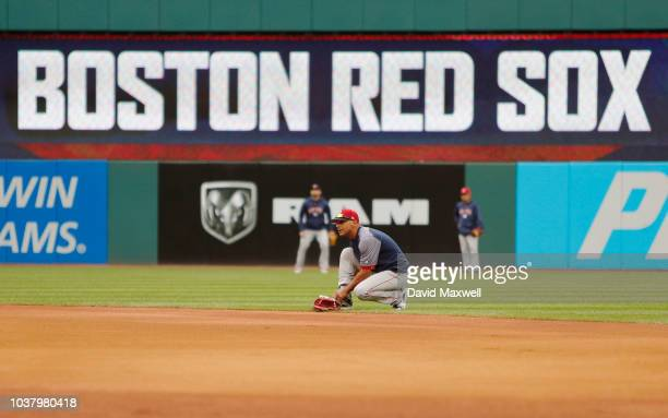 Members of the Boston Red Sox warm up in the outfield before the start of the game against the Cleveland Indians at Progressive Field on September 22...