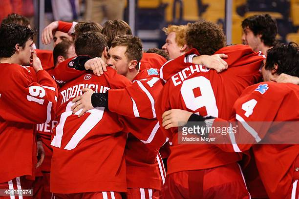 Members of the Boston University Terriers celebrate their win over the Northeastern Huskies 4-3 during overtime in the 2015 Beanpot Tournament...