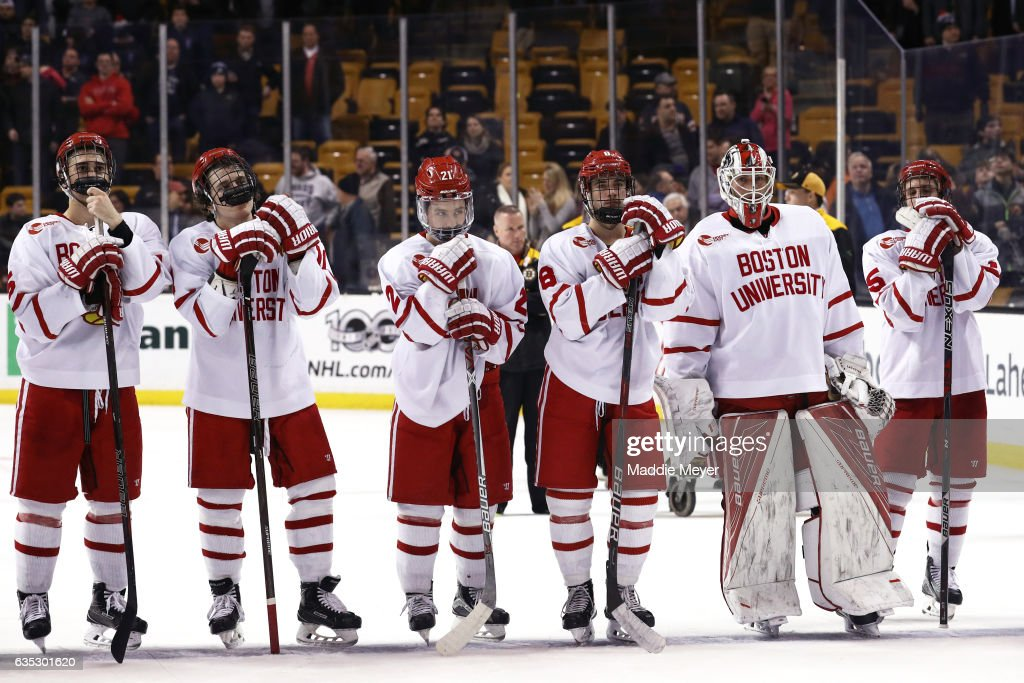 Members of the Boston University Terriers react after losing the 2017 Beanpot Tournament Championship to the Harvard Crimson 6-3 at TD Garden on February 13, 2017 in Boston, Massachusetts.