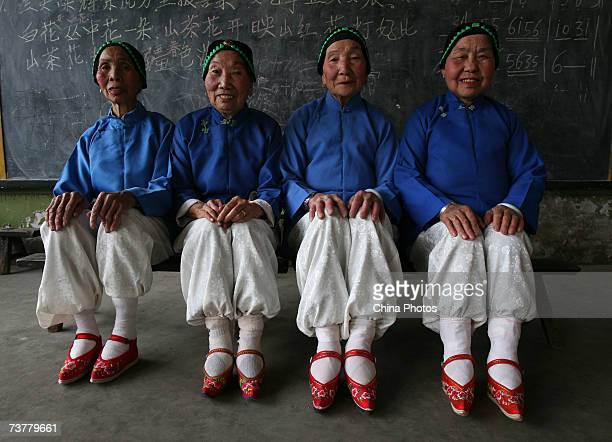 Members of the Bound Feet Women Dancing Team pose for pictures during dancing practice at Liuyi Village on April 2 2007 in Tonghai County of Yunnan...